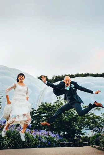wedding entourage photo ideas bride and groom jump toby lowe photography