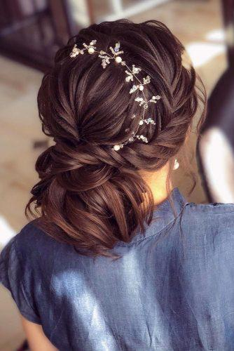 wedding hairstyles every hair length low bun with braided texture on dark hair rayganat_mansurova