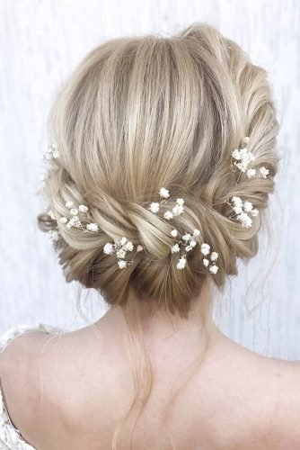 wedding hairstyles for thin hair blonde textured updo with white baby breath flowers julia_alesionok