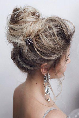 wedding hairstyles for thin hair long blonde slightly messy high bun tonyastylist