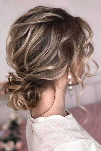 wedding hairstyles for thin hair low bun on blonde hair with soft waves shiyan_marina