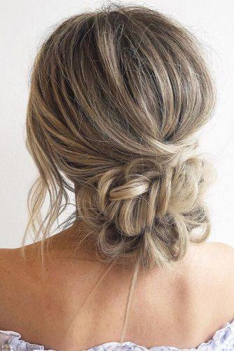 wedding hairstyles for thin hair low bun with braided texture on long hair blohaute