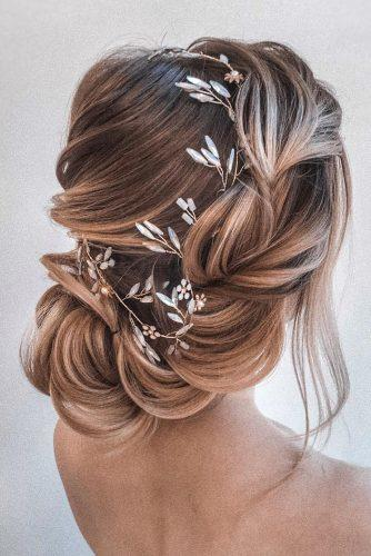wedding hairstyles for thin hair side swept low airy updo with flower and crystals olesya_zemskova