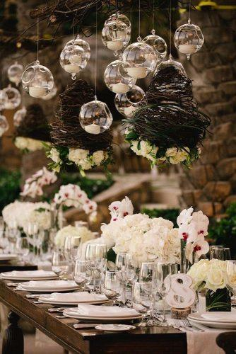 wedding ideas with candles and flowers hanging above the able with orchids chris + lynn photographers
