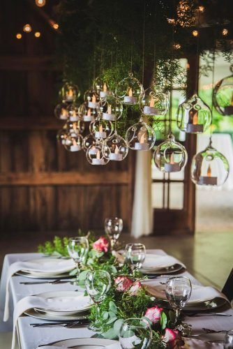 wedding ideas with candles barn reception with flower tablerunner and hanging candles tarrenbaileyphotography