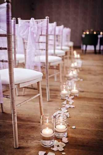 wedding ideas with candles beige light aisle with flower petals matthew bishop photography