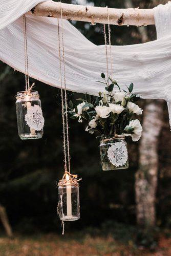 wedding ideas with candles bohemian hanging jars with flowers and macrame marei_photography