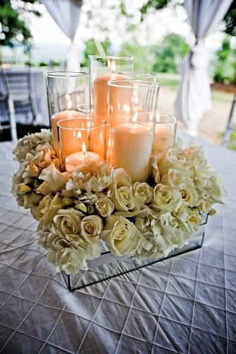 wedding ideas with candles creamy roses and candles in mirror crate centerpiece waldorfphotographicart
