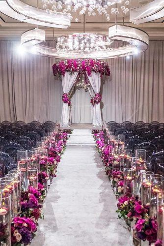 wedding ideas with candles lilac flowers and candles in wedding aisle brian leahy photography