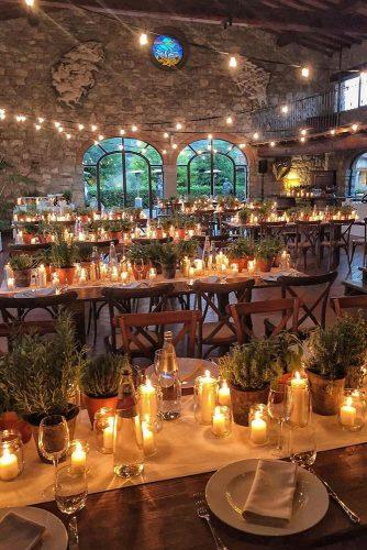 wedding ideas with candles reception with candles and greenery on tables borgo corsignano via instagram