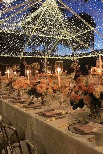wedding ideas with candles reception with candles under transparent tent brookekeegan