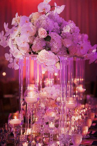 wedding ideas with candles romantic lightings with tall flower centerpiece and candles shawna herring photography