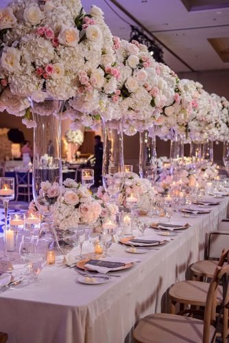 wedding ideas with candles tall glass centerpieces and light pink flower roses edgedesigngroup