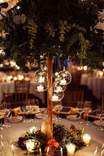 wedding ideas with candles tall greenery tree centerpiece with hanging candles yuliignatova