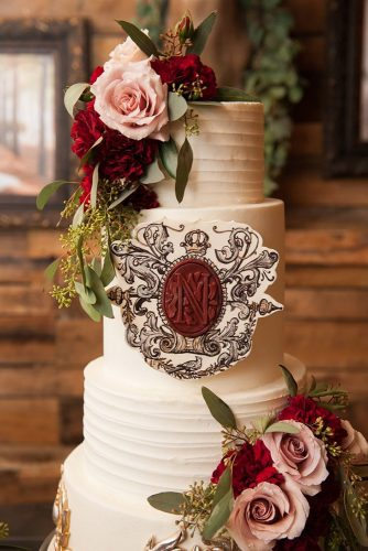 wedding monogram white cake decorated with roses with monogram holli b photography