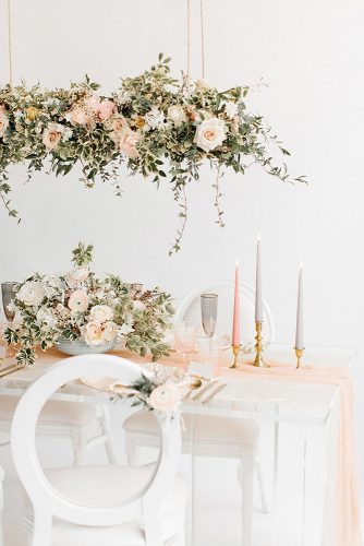 wedding reception decorations white table and chairs pink tablecloth gray vase and candle flowers in pastel pink tones rebecca goddard photography via instagram