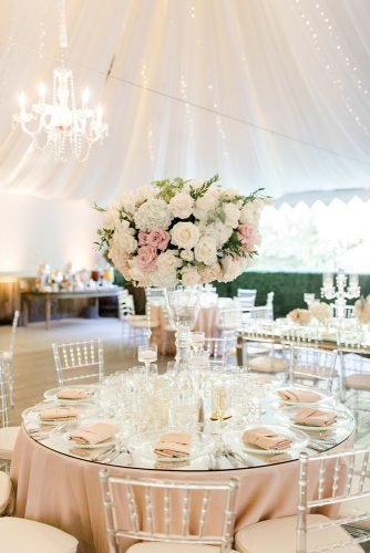 wedding tent blush and white roses with greenery in glass tall vase on round table jenny quicksall photography