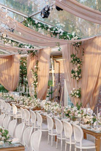 wedding tent dusty rose with cloth bridal reception with greenery and white roses roman_ivanov_weddings