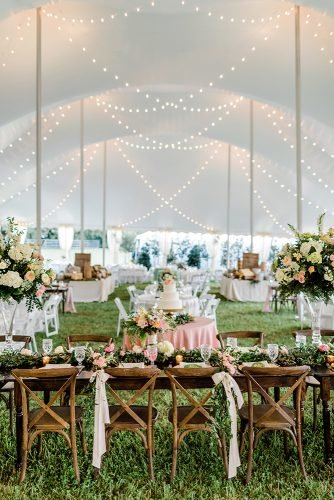 wedding tent elegant pink flowers on wooden tables rustic white photography
