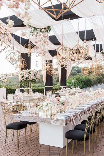 wedding tent modern reception black white with marble teble and gold geometric hanging lighting brandonkiddphoto