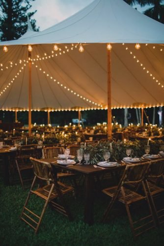 wedding tent outdoor reception with lightings and greenery and candles maui maka photography