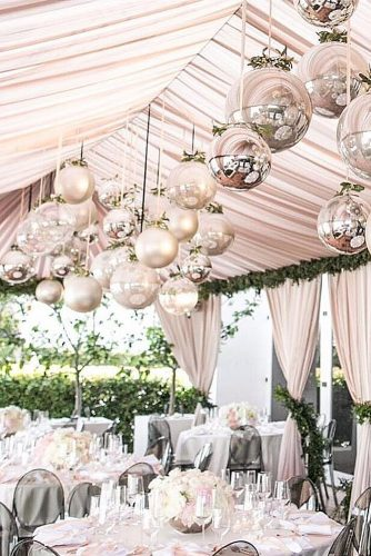 wedding tent pink decorated with mirror balls under the ceiling samuel lippke studios