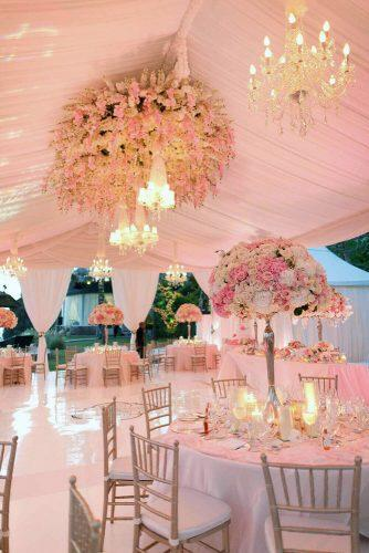 wedding tent reception elegant wedding reception in gose gold tones with tall centerpieces and chandelier samuel lippke studios