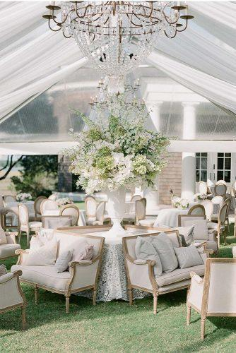 wedding tent romantic white reception with tall bouquet in vase gregfinck