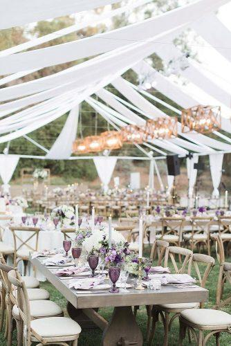 wedding tent summer reception with lilas flowers and glasses brandonkiddphoto