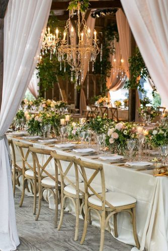wedding tent table with beige tablecloth golden chandelier with appliances and flowers samuel lippke studios