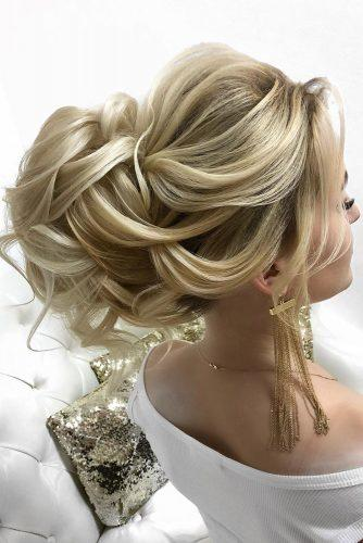 wedding updos for long hair elegant high bun with curls on blonde hair lyubov_nevskaj