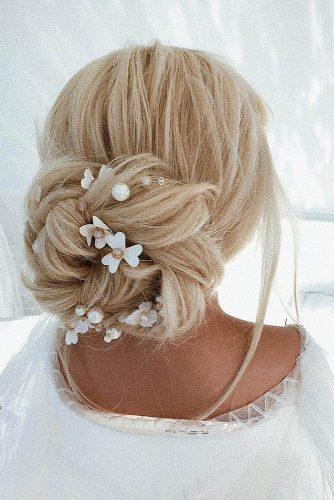 wedding updos for long hair elegant low volume bun with white flowers ulyanaasterbridal