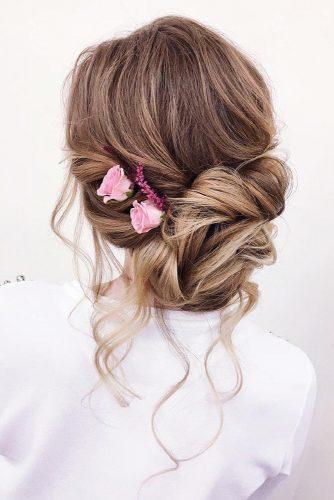 wedding updos for long hair elegant soft updo with pink roses xenia_stylist via instagram
