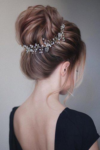 wedding updos for long hair high ballet textured bun with halo accessory tonyastylist