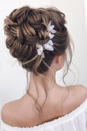 wedding updos for long hair high textured updo with gentle flowers xenia_stylist via instagram