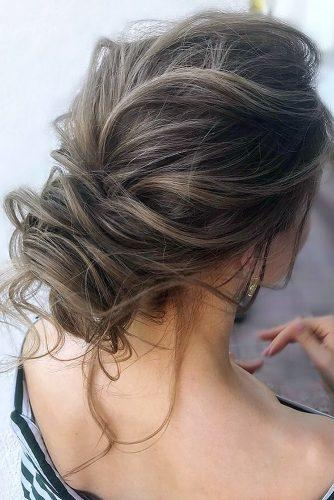wedding updos for long hair low slightly messy updo with loose curls julia_alesionok