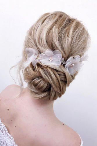 wedding updos for long hair low updo with gentle flowers xenia_stylist via instagram