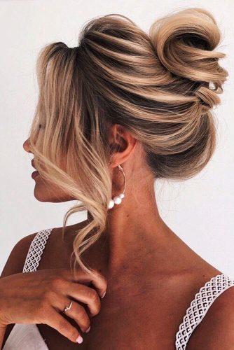 wedding updos for long hair textured elegant high bun with loose curls elstilespb