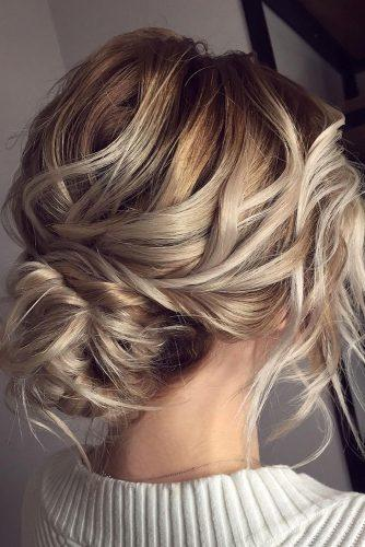 wedding updos for medium hair curly slightly messy low bun on blonde veronika_belyanko