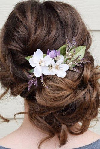 wedding updos for medium hair low updo on dark hair with flowers wb_upstyles
