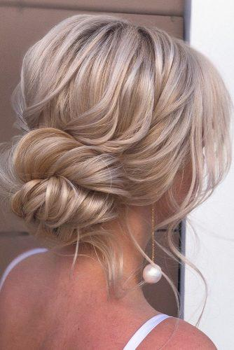wedding updos for medium hair messy low updo on blonde hair xenia_stylistslightly