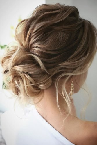 wedding updos for medium hair romantic low updo on textured blonde hair lenabogucharskaya