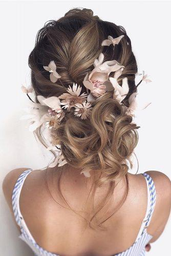 wedding updos for medium hair swept low bun with pink flowers hair_vera