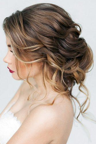wedding updos for medium hair tender curls in low updo elstilespb via instagram