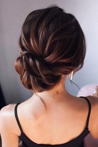 wedding updos for medium hair textured elegant low updo on dark hair tonyastylist