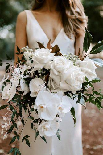 white wedding bouquets inspiration cascading bridal bouquet with orchid and roses with greenery jannekestorm