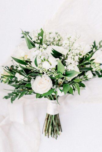 white wedding bouquets inspiration white with roses wildflowers and leaves greenery michellefloresphotography via instagram
