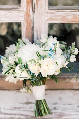 white wedding bouquets inspiration with white roses and small blue flowers valoriedarling via instagram