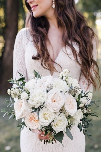white wedding bouquets of roses with greens in the hands of the bride natalie andrusiak via instagram