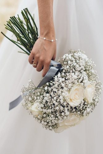 white wedding bouquets with baby breath and roses gray ribbon faith brennan via instagram